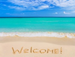 Word Welcome on beach